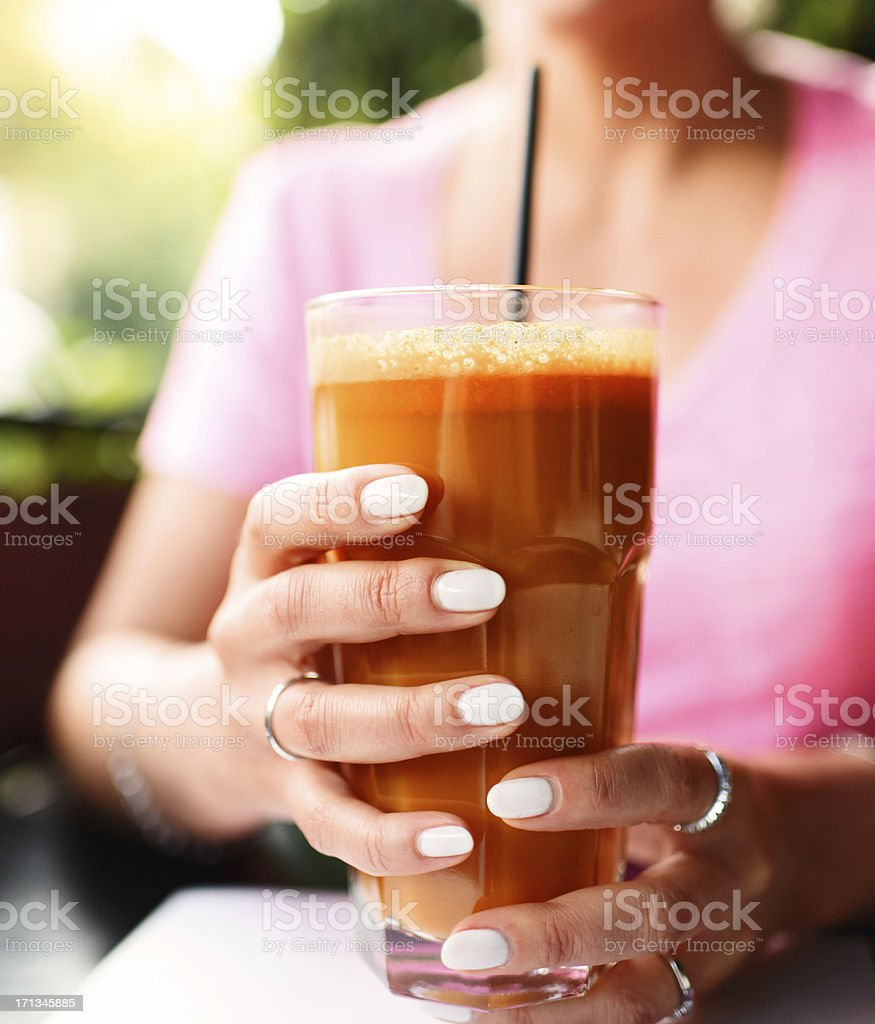Woman holding Fresh Carrot and Celery  Juice stock photo