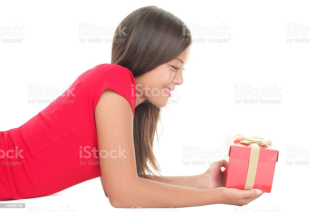 Woman holding gift isolated royalty-free stock photo