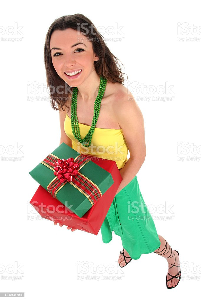 Woman holding gifts royalty-free stock photo
