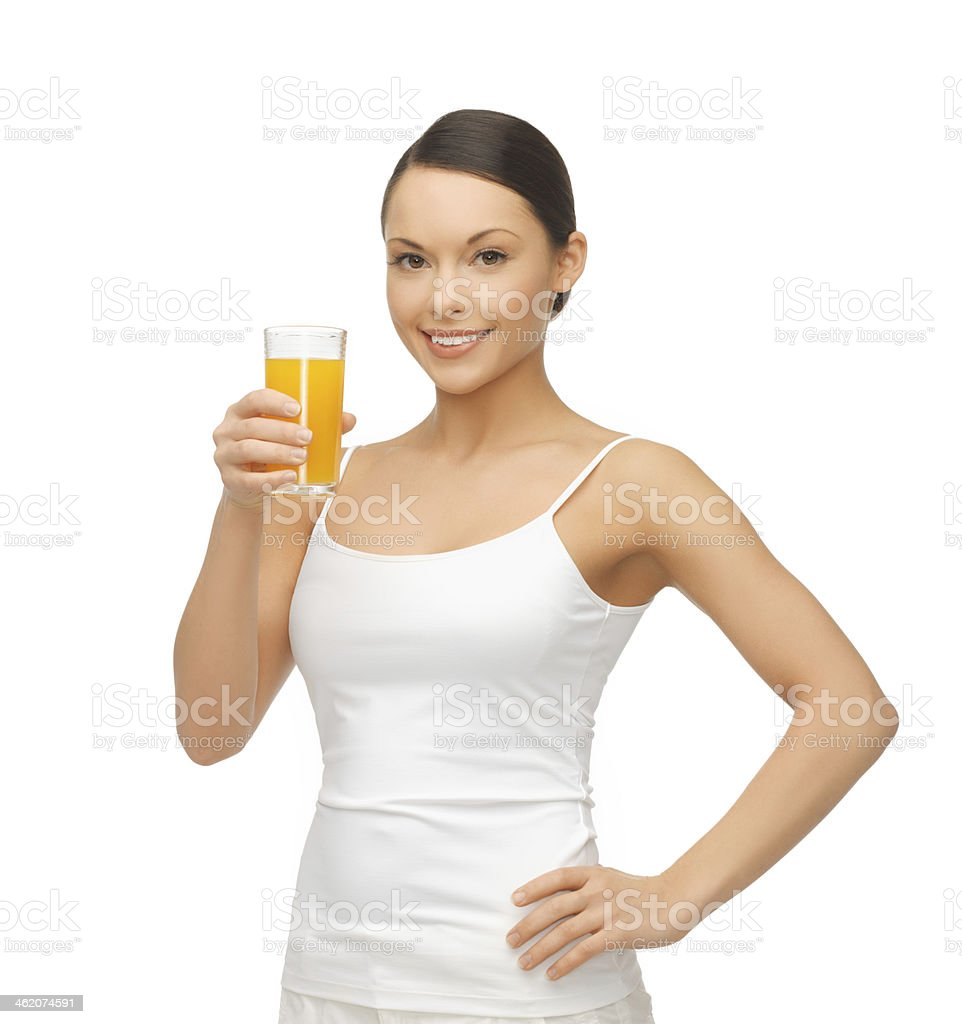 woman holding glass of orange juice stock photo