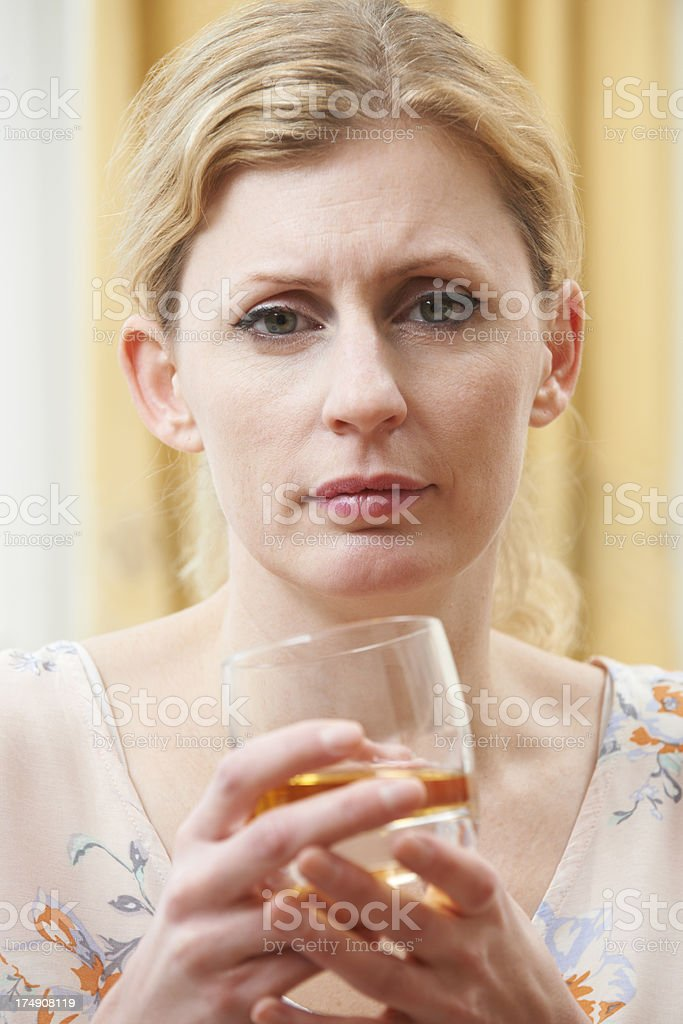 Woman Holding Glass Of Whiskey royalty-free stock photo
