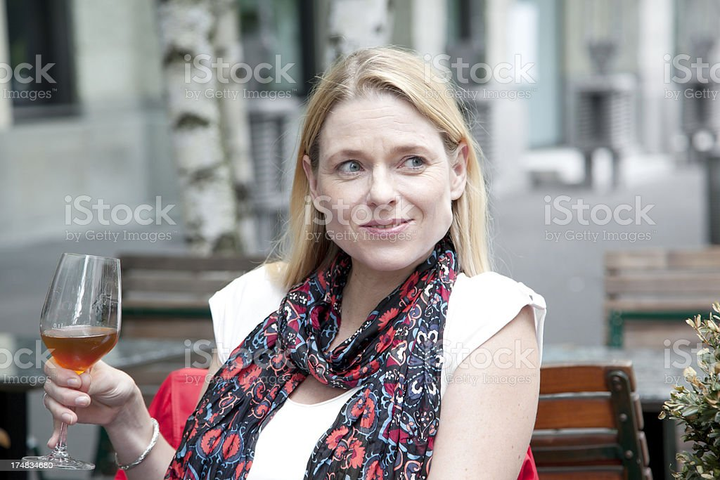 woman holding glass of wine looking away royalty-free stock photo
