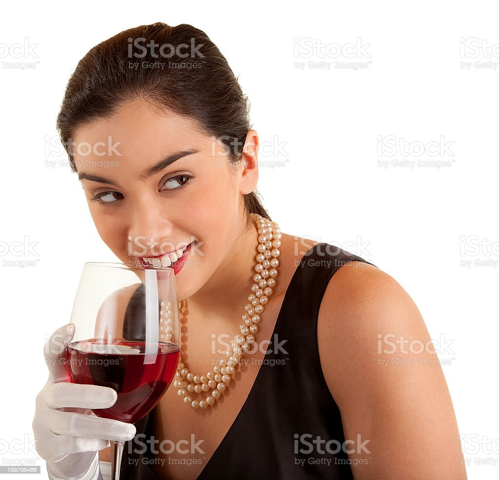 Woman Holding Glass of Wine Looking Sideways royalty-free stock photo