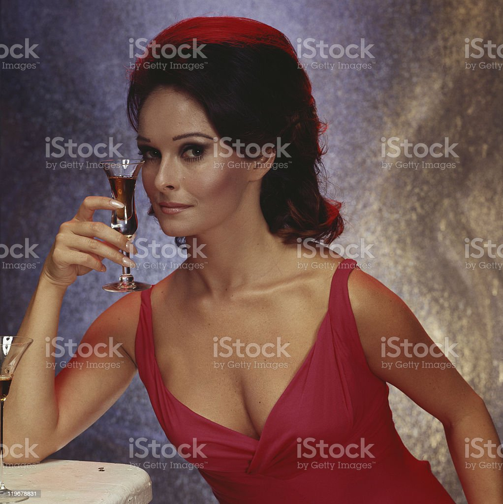 Woman holding glass of wine, portrait, close-up stock photo