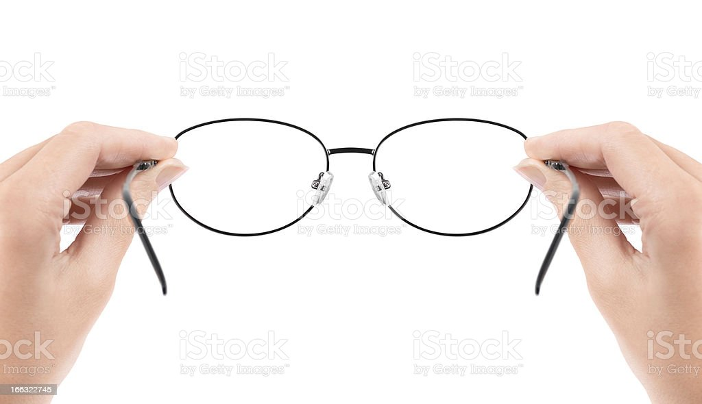 Woman holding glasses in hands stock photo