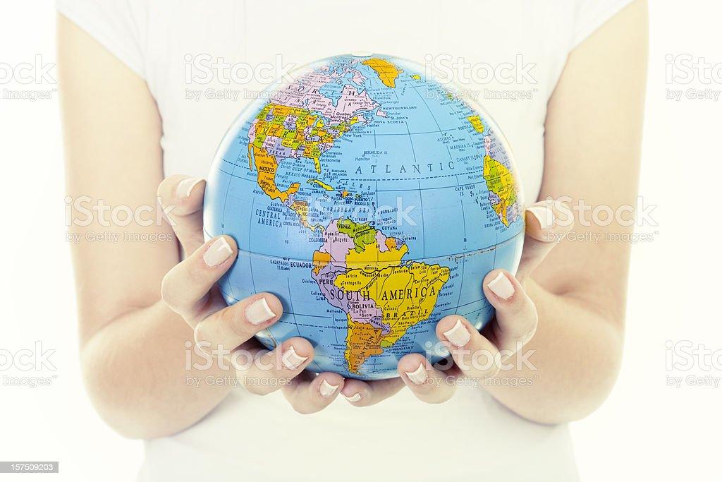 Woman holding globe royalty-free stock photo