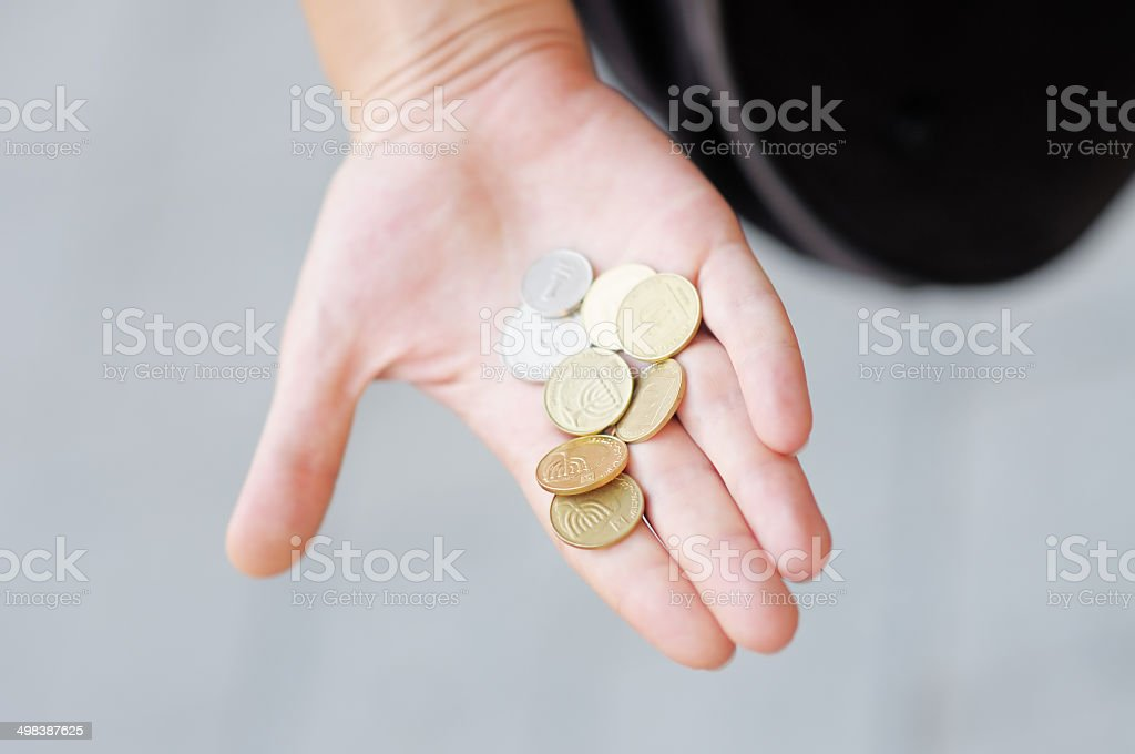 Woman holding golden and silvery coins stock photo