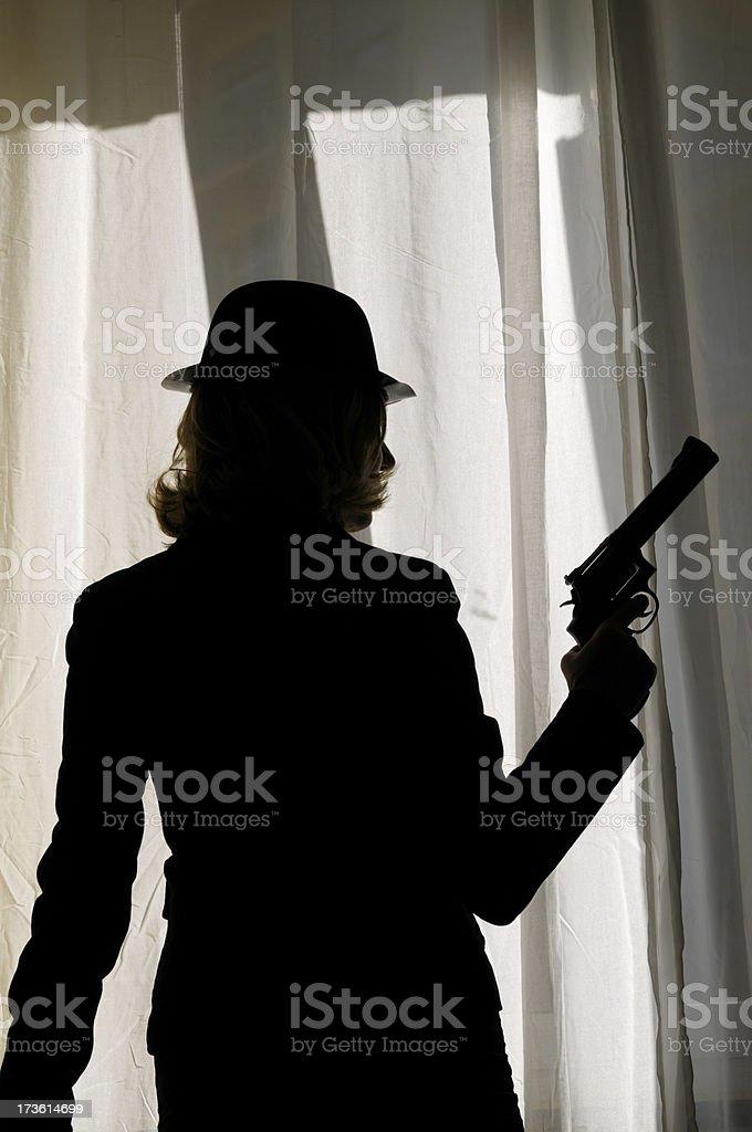 Woman Holding Gun Behind a Window royalty-free stock photo