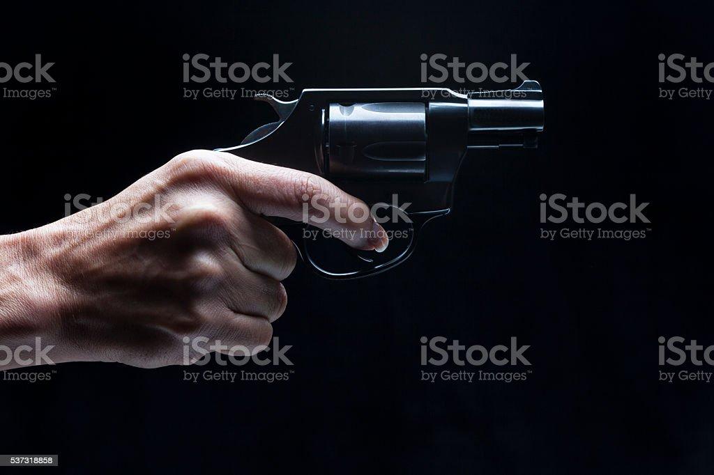 Woman holding handgun stock photo