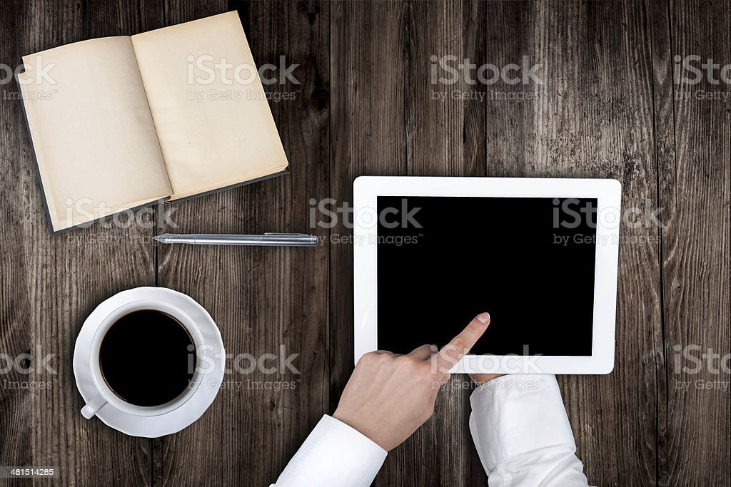 Woman holding hands of a tablet royalty-free stock photo