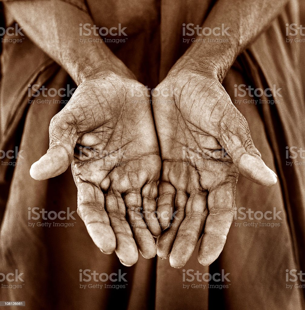 Woman Holding Hands Out with Plams Facing Up, Sepia Toned royalty-free stock photo