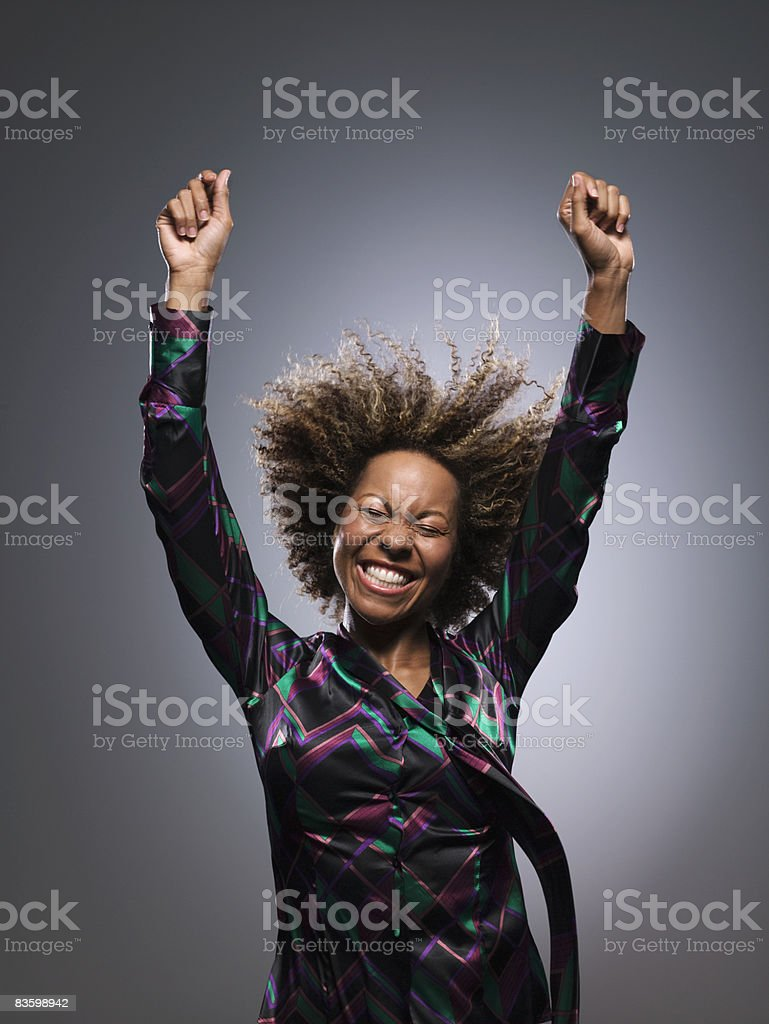 Woman holding hands up in air stock photo