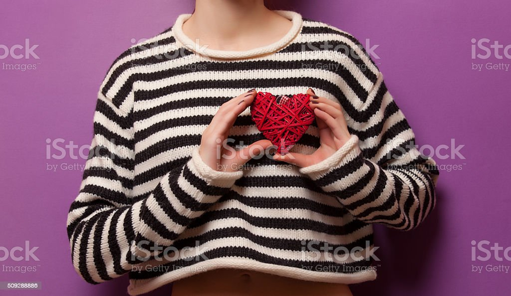 Woman holding heart shape toy stock photo