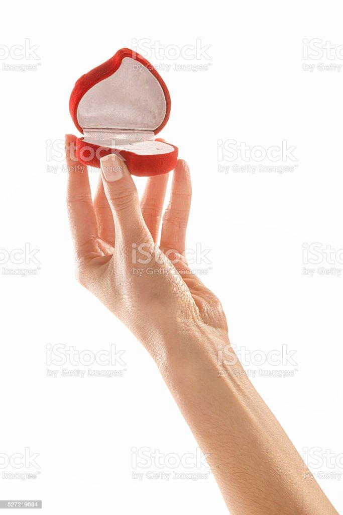 Woman holding heart shaped jewelry box stock photo