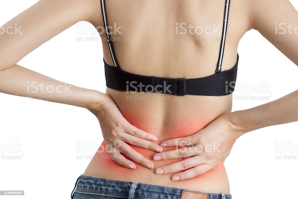 Woman holding her back in pain stock photo
