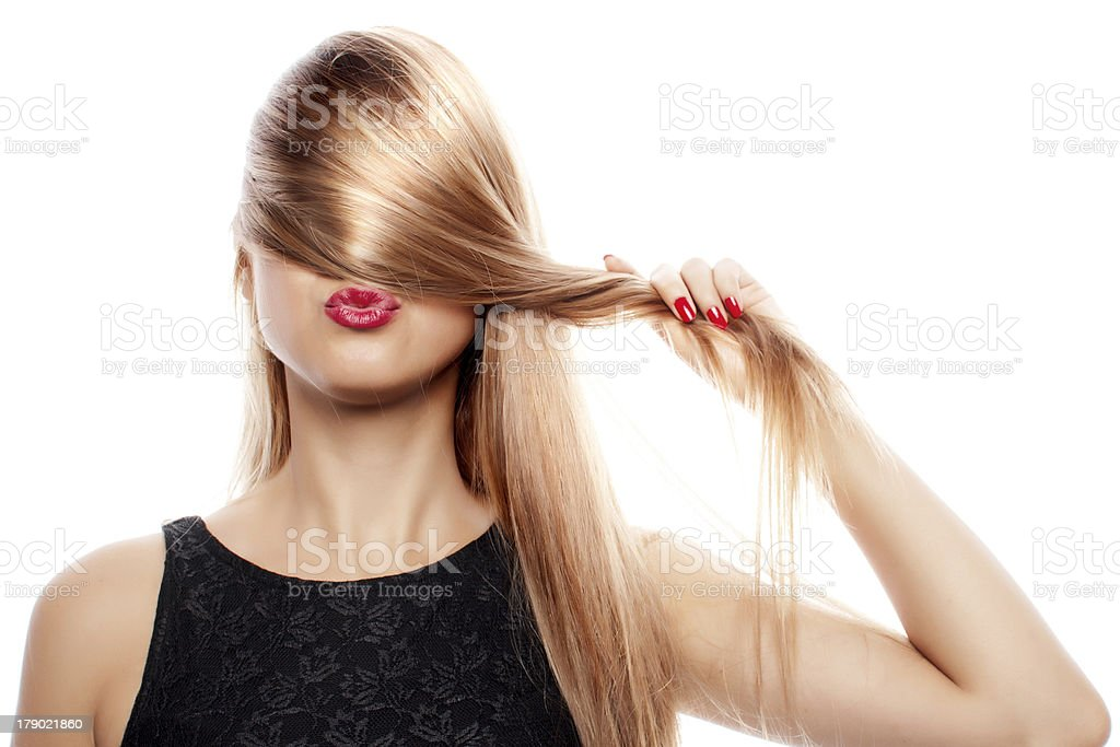 A woman holding her blonde hair over her eyes and nose stock photo