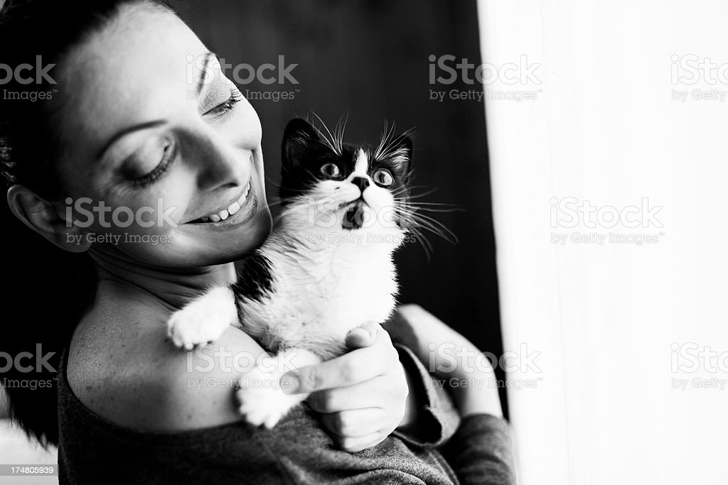 Woman holding her Cat royalty-free stock photo