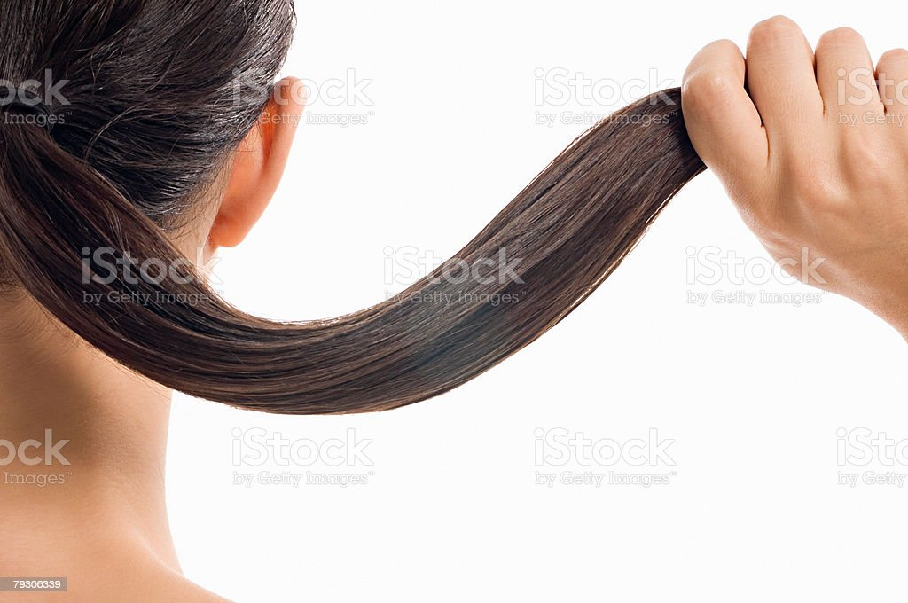 Woman holding her hair stock photo