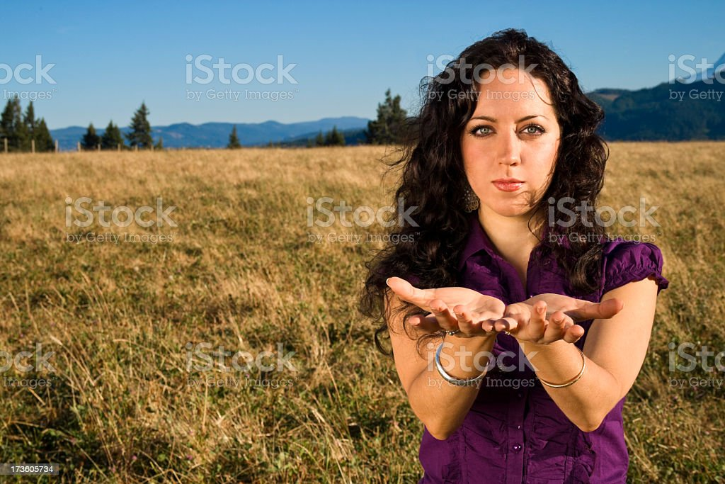 Woman holding her hands out as an offering stock photo