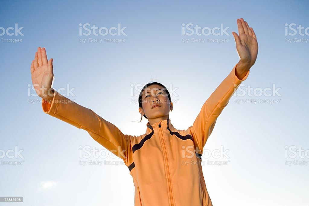 Woman holding her hands out royalty-free stock photo