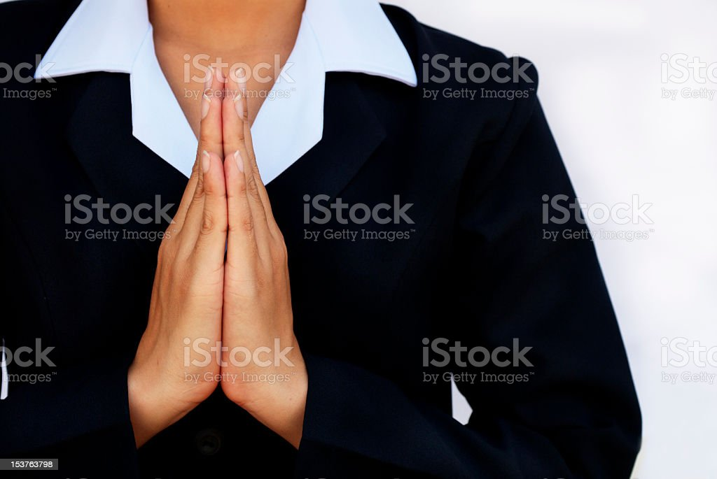 Woman holding her hands together royalty-free stock photo