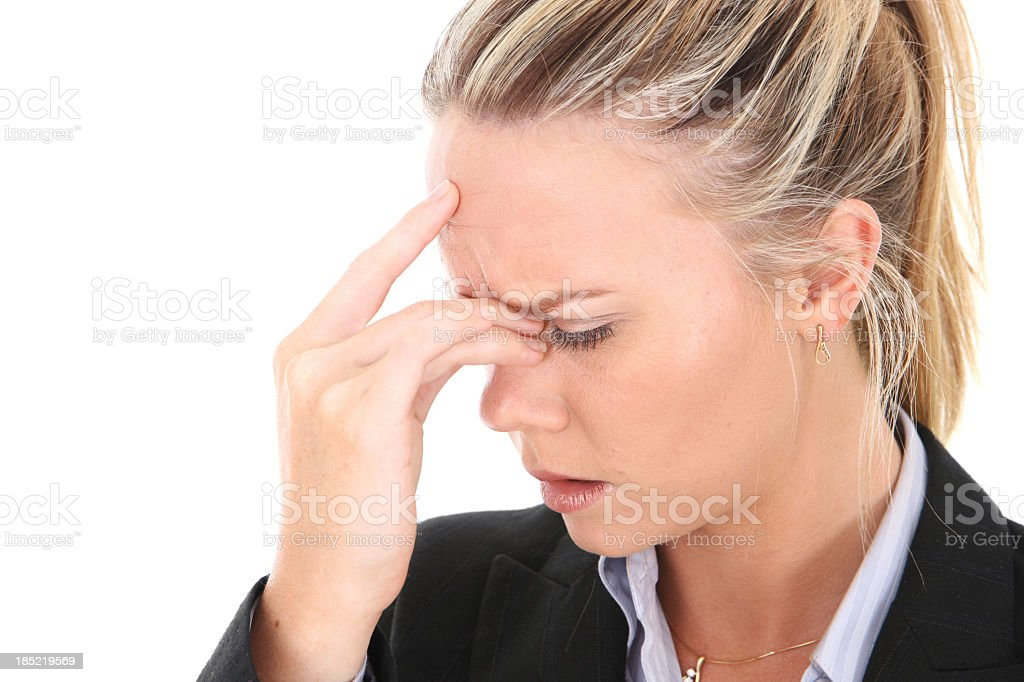 A woman holding her head in pain stock photo