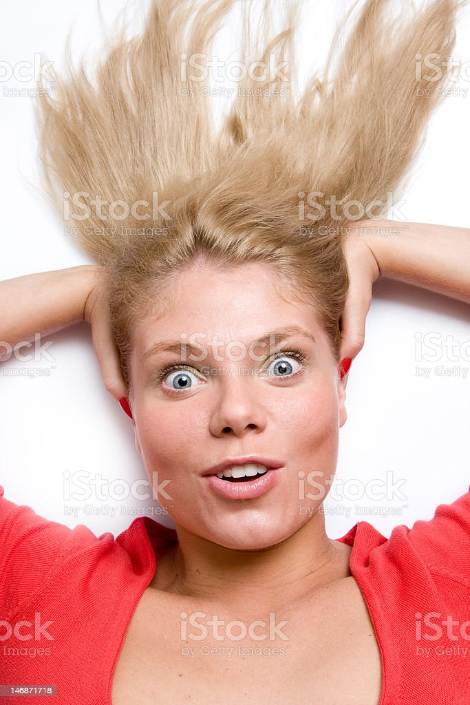 Woman holding her head looking up surprised royalty-free stock photo