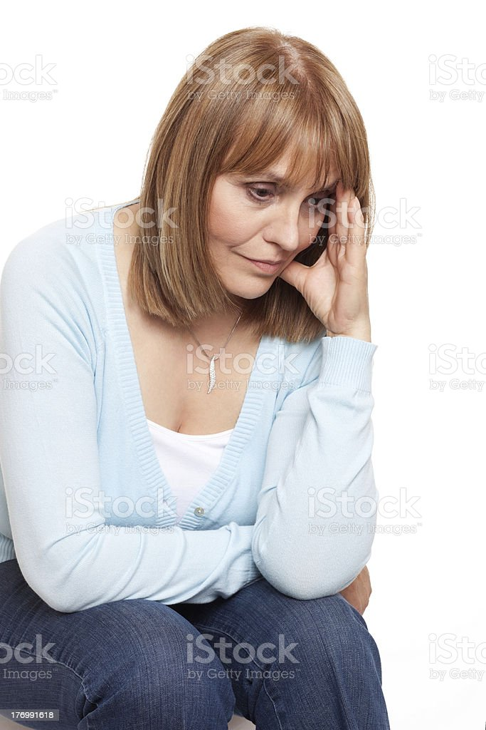 Woman holding her head showing signs of a headache royalty-free stock photo