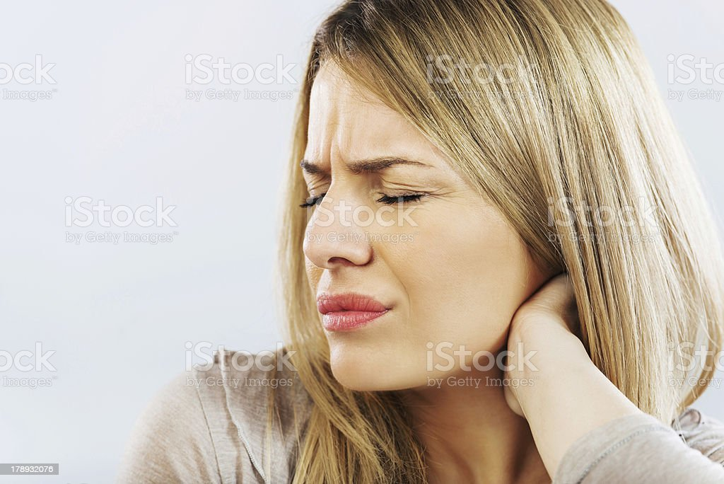 Woman holding her neck in pain. royalty-free stock photo