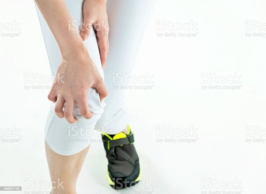 Woman holding her painful knee stock photo
