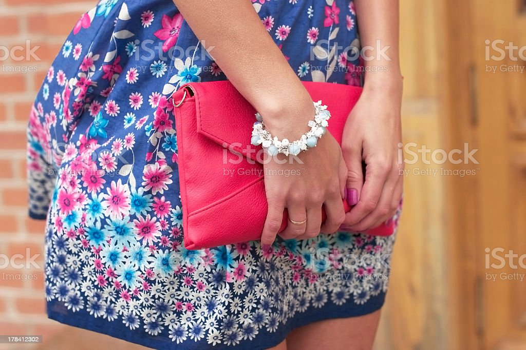 Woman holding her purse stock photo