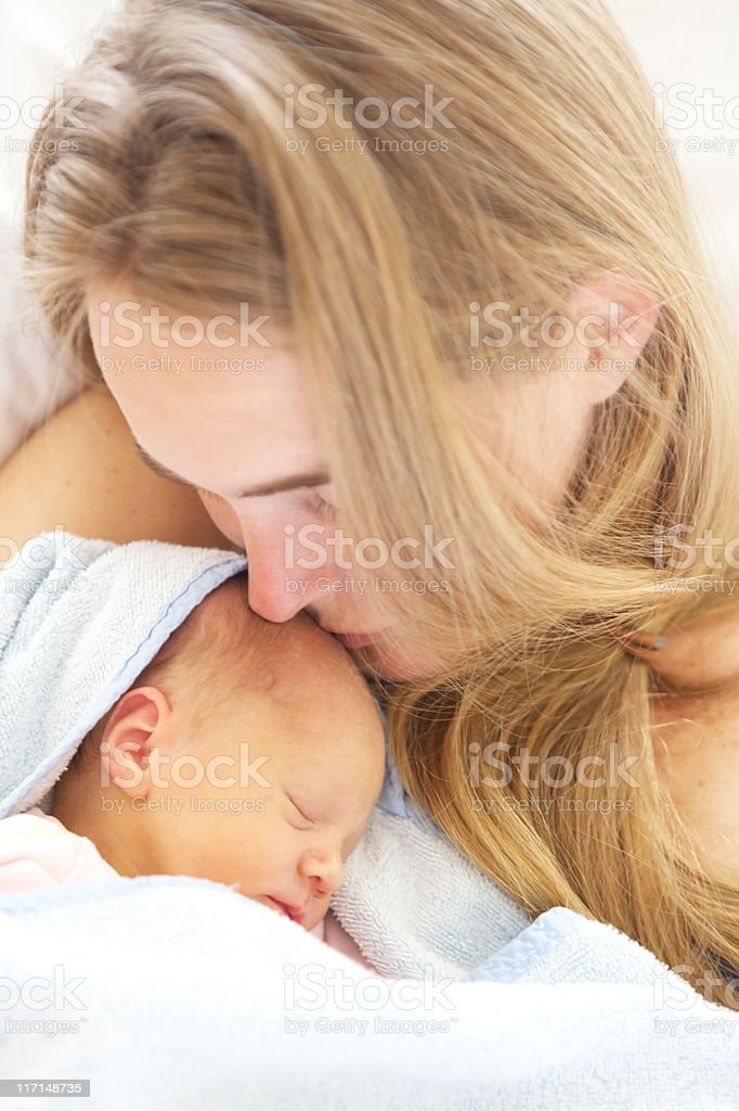 woman holding her sleeping 2 days old daughter. royalty-free stock photo