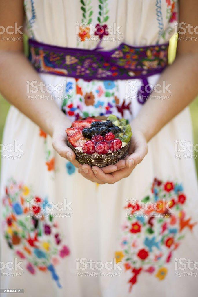 Woman Holding Homemade Fruit Tart Dessert stock photo