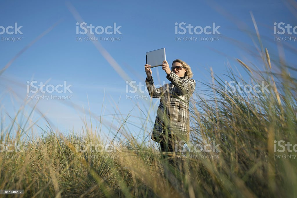 Woman holding in sand dunes .Norfolk Beach. UK royalty-free stock photo