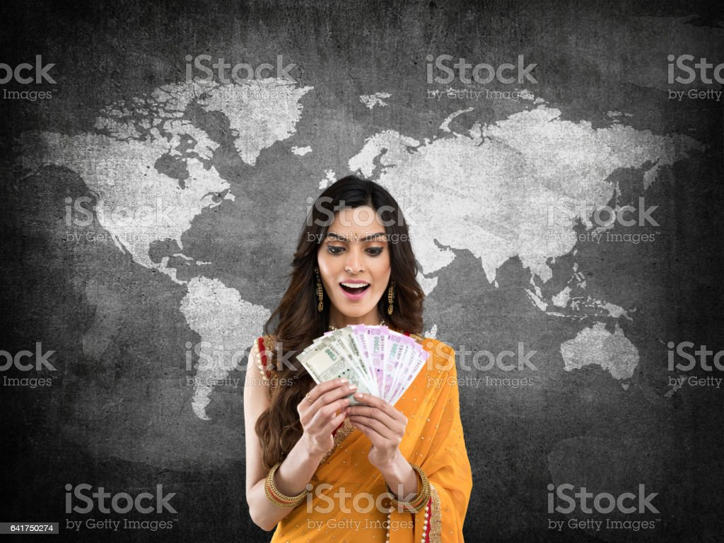 Woman holding Indian paper currency stock photo