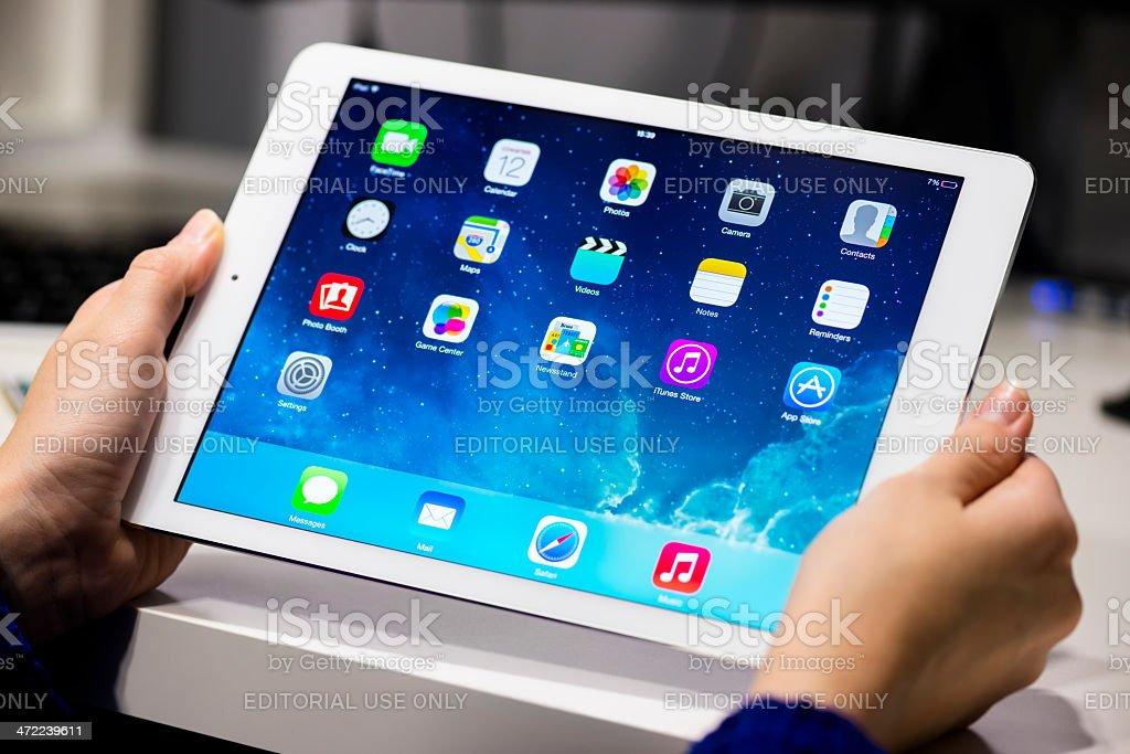 Woman holding iPad Air royalty-free stock photo