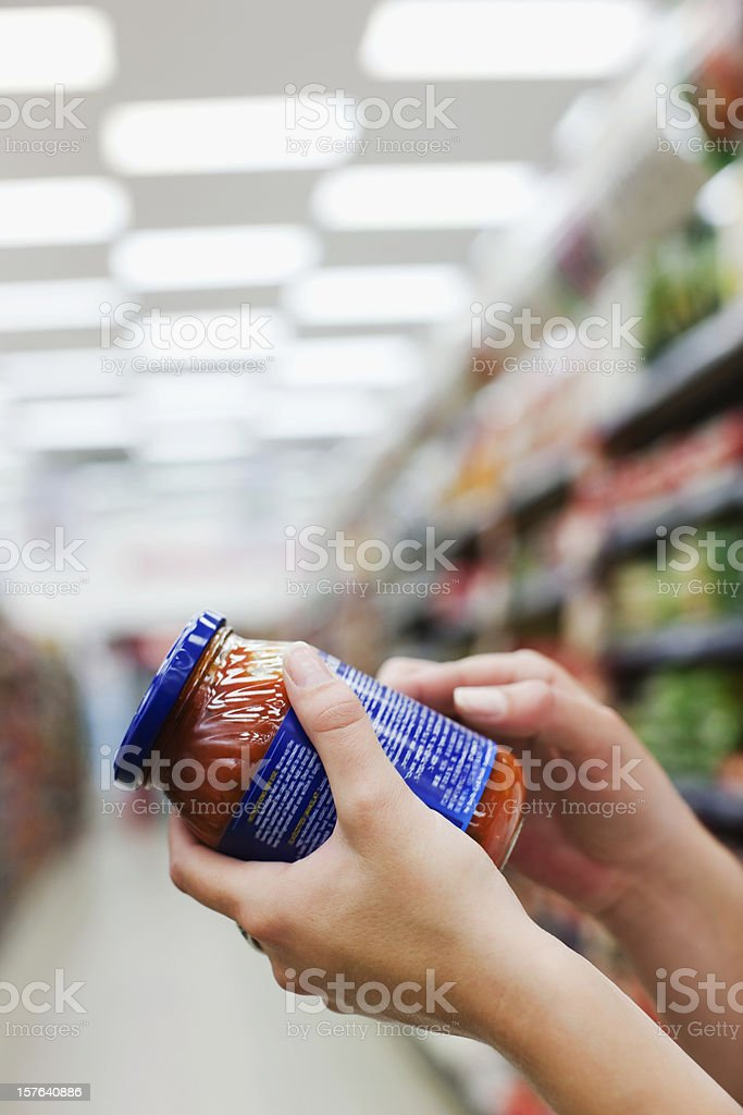 Woman Holding Jar of Food stock photo