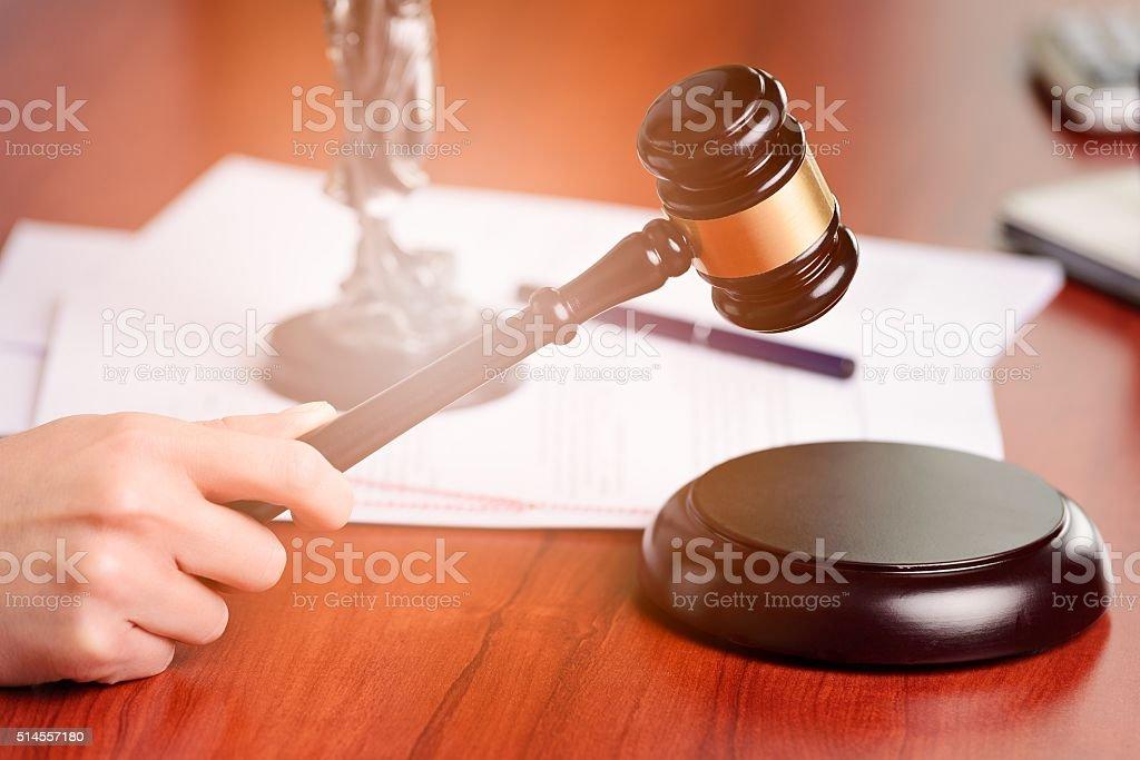 Woman holding judge gavel stock photo