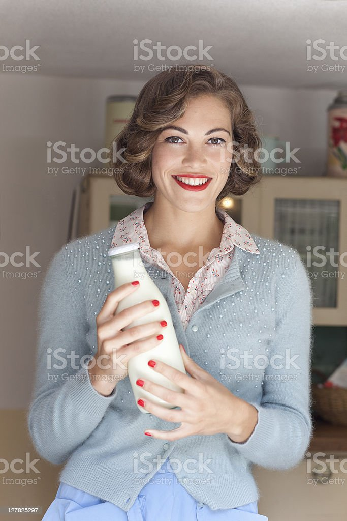 Woman holding jug of milk stock photo