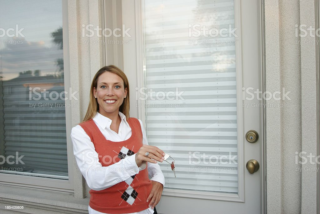 Woman Holding Keys to House royalty-free stock photo