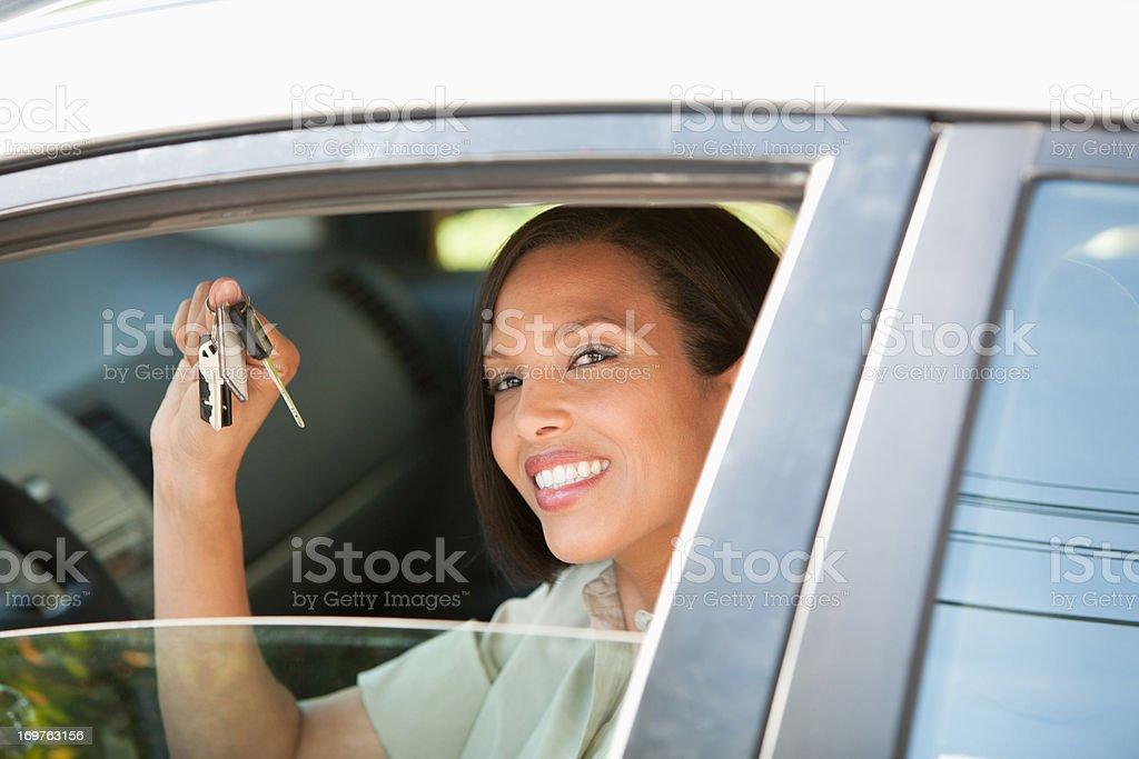 Woman holding keys to new car royalty-free stock photo