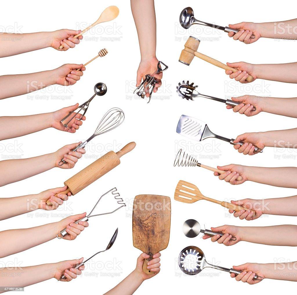 Woman holding kitchen utensils stock photo