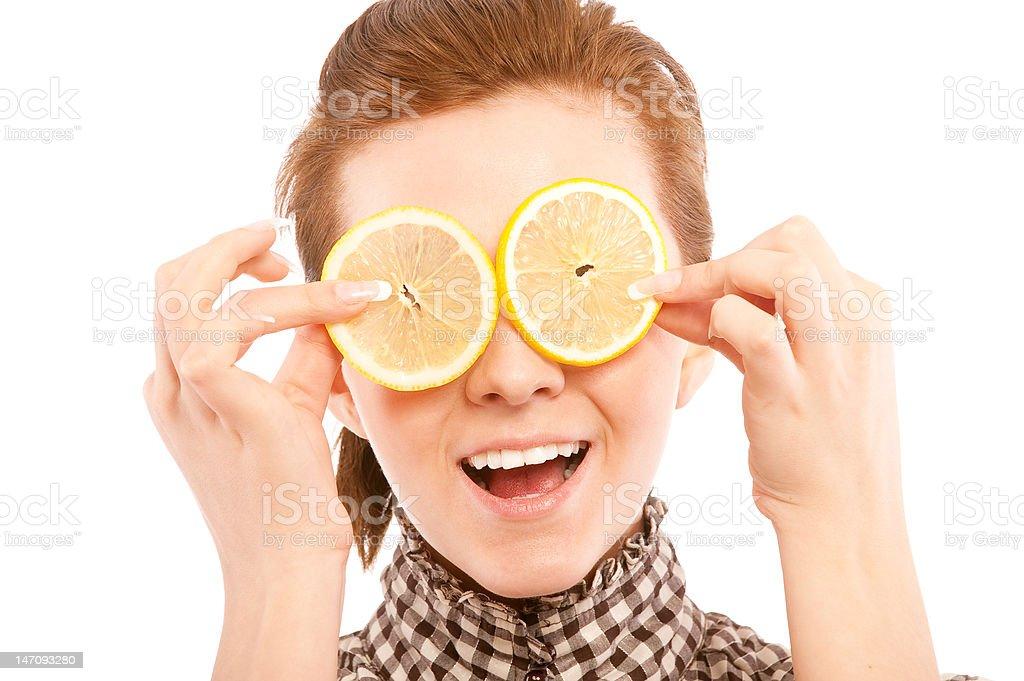 Woman holding lemon near her eyes royalty-free stock photo