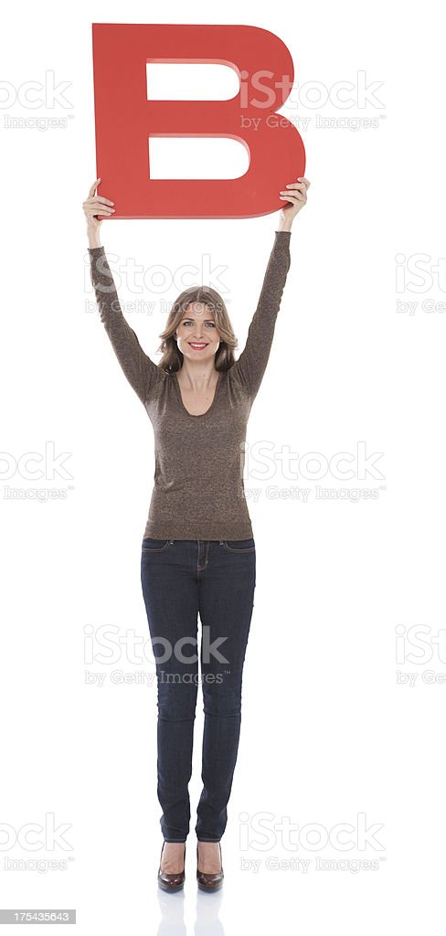 Woman holding letter B. royalty-free stock photo