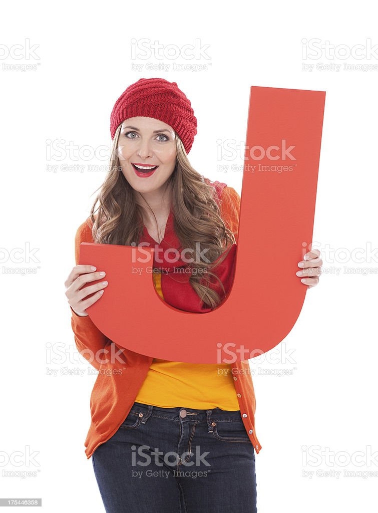 Woman holding letter J. royalty-free stock photo