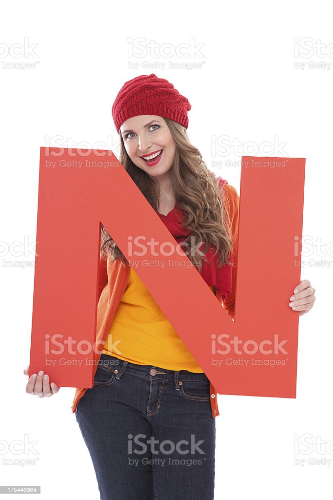 Woman holding letter N. royalty-free stock photo