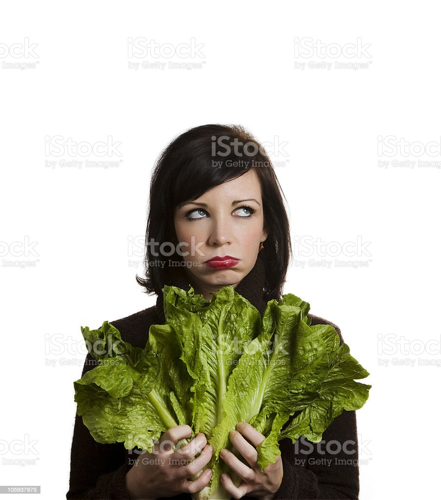 Woman holding lettuce leaves and frustrated face stock photo