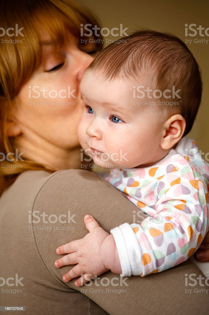Woman holding little baby royalty-free stock photo