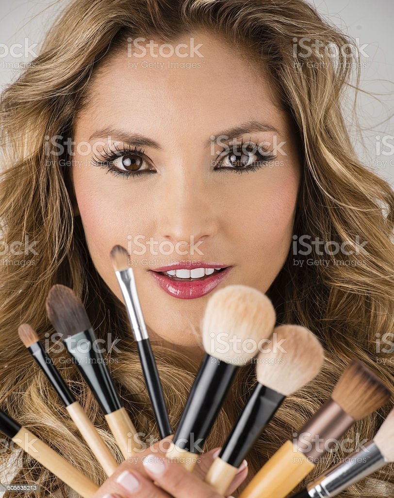 Woman holding makeup brushes stock photo