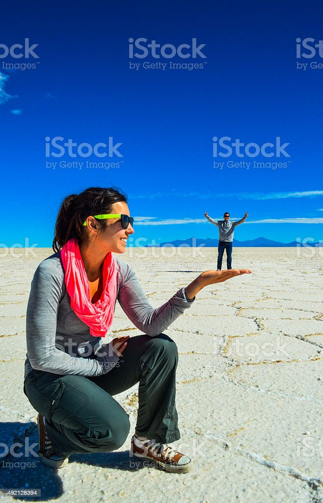 Woman holding man in palm of hand stock photo